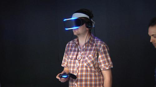 A visitor to the Game Developers Conference in San Francisco tries out a Sony Project Morpheus headset on March 19, 2014.