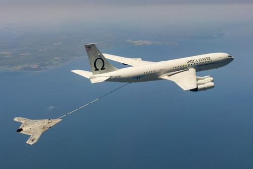 The U.S. Navy's unmanned X-47B receives fuel from an Omega K-707 tanker while operating in the Atlantic Test Ranges over the Chesapeake Bay. This test marked the first time an unmanned aircraft refueled in flight
