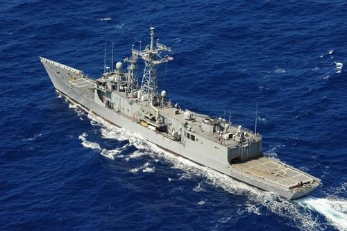 The guided-missile frigate USS McClusky transits to a formation of U.S. and coalition forces during Rim of the Pacific 2010 exercises.