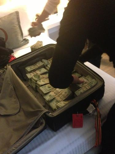One of the defendants, Saul Franjul, allegedly took a photo on his iPhone of $800,000 in cash stuffed into a suitcase, intended for delivery to another member of the group.