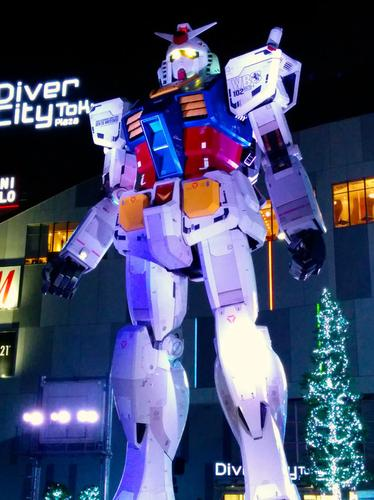 An 18-meter-tall statue of Gundam, a robot featuring in a popular Japanese science-fiction franchise, is lit up in Odaiba, Tokyo. A group of companies and fans wants to create a moving, 18-meter-tall robotic version of Gundam.