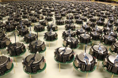 The Kilobots, a swarm of one thousand simple but collaborative robots