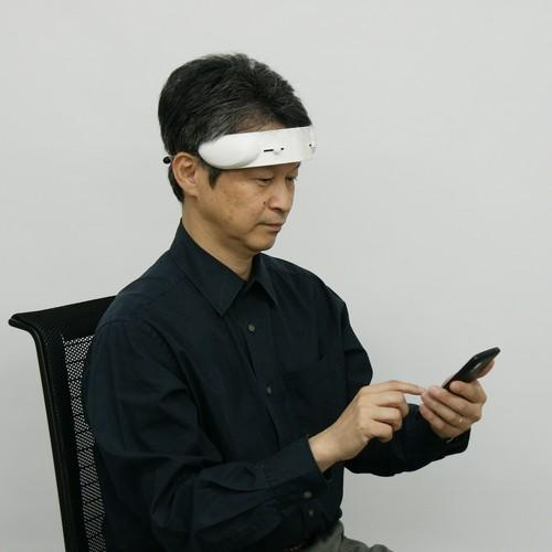 Hitachi High-Tech's forehead brain activity sensor works with a smartphone app to improve learning and memory skills.