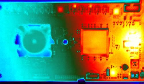 """The IBM """"TrueNorth"""" chip is designed for low power consumption, shown in this thermal image that shows the cool TrueNorth chip alongside hot FPGA chips that are feeding data to  TrueNorth."""