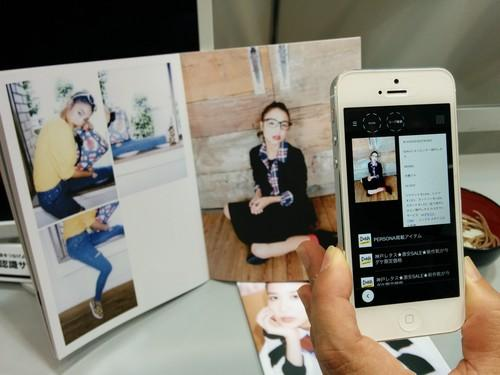 An NEC staffer shows how the image-recognition app Gaziru is used to recognize products in a new, text-free fashion magazine called Persona and then download related information from a cloud server.