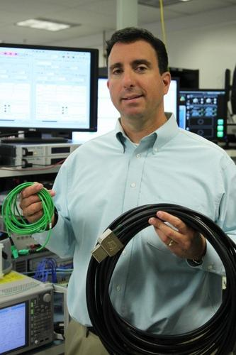 MXC optical and copper PCI-Express cable held by Mario Paniccia, Intel Fellow and general manager of the silicon photonics operations
