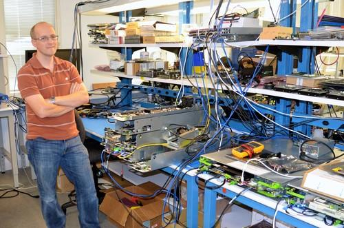 Matt Corddry, director of Facebook's hardware engineering lab, with some of the gear his team builds