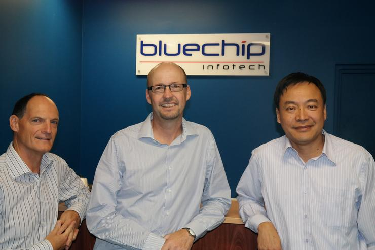 Former TrackITOnline manager, Phil Lancaster, with Bluechip Infotech sales director, Ron Jarvis, and Bluechip Infotech managing director, Johnson Hsiung, after the two companies merged.