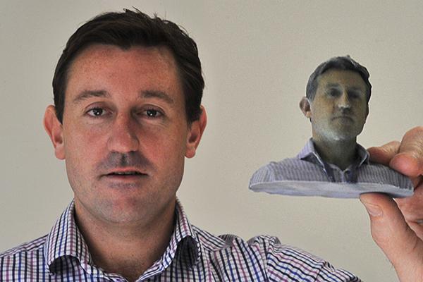 ARN senior journalist Brian Karlovsky shows off a 3D printed portrait.