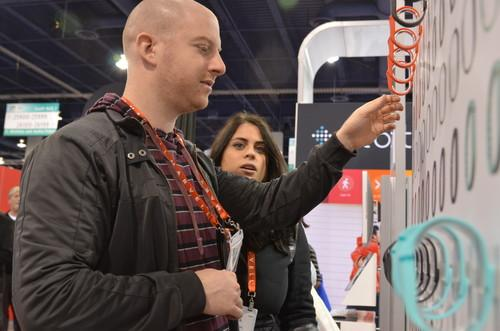 CES attendees check out the fitbit booth, looking at the fitbit flex, a wireless wristband that tracks steps, distance, calories and sleep. All can be managed from a mobile device.