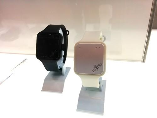 Wristband sensors that can detect heart rate and temperature as part of an IoT platform for monitoring workers and patients are shown off at a Fujitsu tech fair in Tokyo on Tuesday.