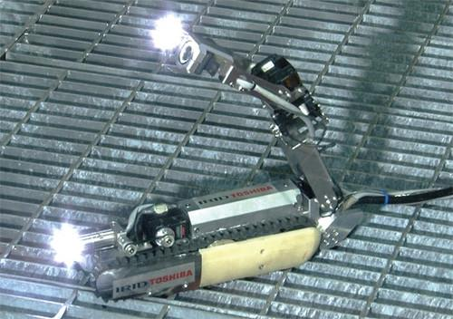 A photo released June 30, 2015, shows a robot developed by Toshiba to probe the state of melted-down fuel in one of the reactors at the crippled Fukushima Dai-ichi nuclear power plant in northern Japan.