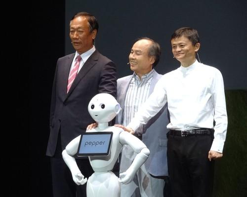 From left to right, Foxconn Technology Group CEO Terry Gou, SoftBank CEO Masayoshi Son and Alibaba founder Jack Ma pose with household communications robot Pepper at Maihama, Chiba, June 18, 2015.
