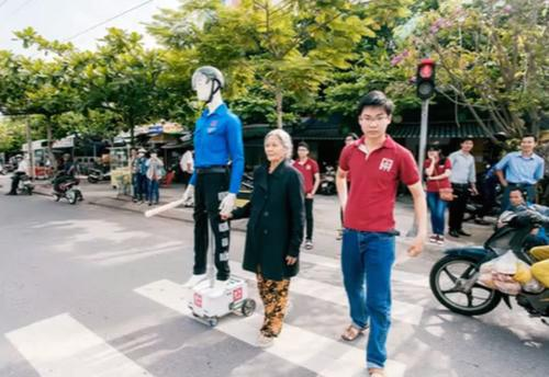 Researchers from Duy Tan University in Vietnam installed a humanoid robot on a wheeled platform and have experimented with it at zebra crossings in Da Nang to help people cross busy streets.