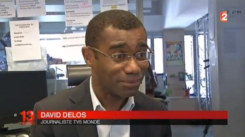 Screenshot of a French TV broadcast showing TV5Monde login credentials in the background