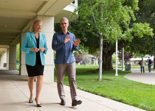 Apple CEO, Tim Cook, and IBM CEO, Ginni Rometty, walk and talk.