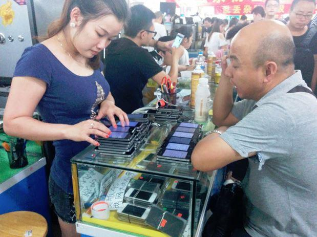In Pictures: Inside a thriving Shenzhen market for used iPhones