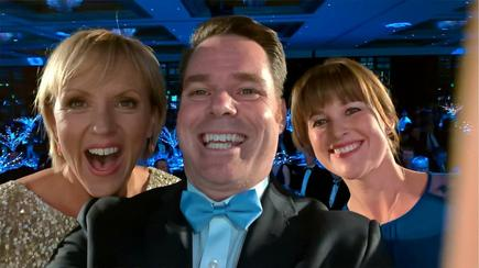 Hilary Barry takes a selfie with Microsoft staff on stage