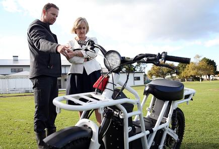 L-R: Timothy Allen (Ubco bikes) and Hon. Amy Adams (Minister of Communications)